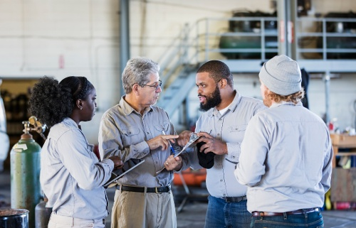 Deskless workers in a warehouse going through training