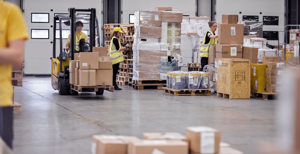 Deskless employees doing audits in a warehouse